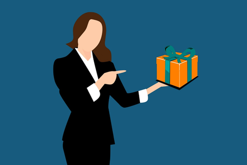 An illustration of a woman in a suit holding a gift box