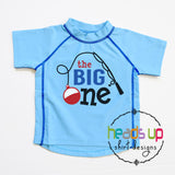 swim shirt rashguard cute popular best seller one year old THE BIG ONE fishing swimming pool party theme. cake smash photo shirt fishing pole bobber. Blue boy girl kids toddler youth 1 year old one 1st first birthday bday party apparel shirt. sun protection SPF beach lake cruise vacation surf ocean birthday rashguard swim shirt unisex fast shipping