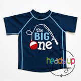 One year old The Big One fishing theme birthday party swim shirt rashguard sun protection SPF 50 1 one 1st first bday birthday bash. swimwear swimsuit swim rashguard beach surf shirt pool swimming lake boating vacation cruise. Bobber fishing pole. boy girl kids toddler baby unisex short sleeve swim shirt