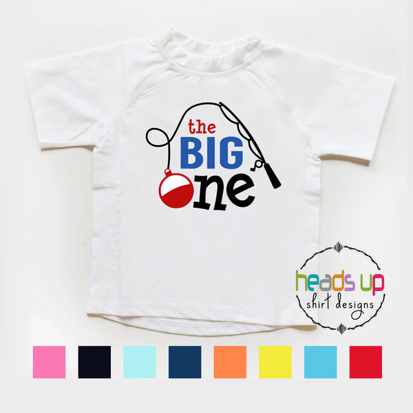 birthday rashguard the big one birthday theme one year old 1 1st first birthday bday party apparel custom fishing bobber swim pool beach ocean vacation cruise. SPF sun protection soft comfortable 2 3 4 5 white red blue cute popular design best seller fast shipping. Heads up Shirts quality custom kids clothing.