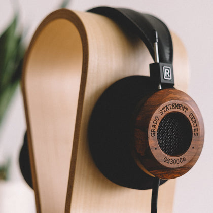 wooden stands for headphones to organize your desk and it can be great gift for music lover