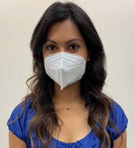 Woman, long dark hair in a blue top, wearing a KN95 face mask from C19PPE.org.  It has ear loops to hold the face-mask tight to your face, is made of a soft material & has a thin metal band to help seal around your nose.  The protective face mask helps protect you and your family from COVID-19 virus by filtering up to 95 percent of particles you breathe in. Cloth face masks do not filter the air that your breathe in and therefore do little to protect you and your family from COVID-19 virus.