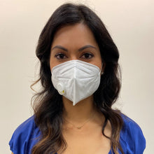 Load image into Gallery viewer, Woman, long dark hair in a blue top, wearing a KN95 face mask from C19PPE.org.  The face-mask has an exhaust vent valve & ear loops to hold the face mask tight to her face.  It helps protect you from COVID-19 virus by filtering up to 95 percent of particles you breathe in.  Exhaust valve vents the hot moist air you breathe out so your glasses don't fog up as much & minimizes the formation of pimples from the hot moist air.  Made of a soft material & has a thin metal band to help seal around your nose.