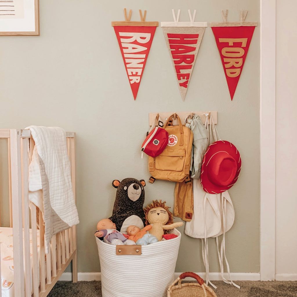 Ford, Harley, and Rainer custom name pennants with vintage color-ways in kids' room