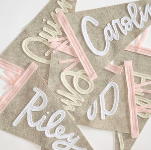 Cursive Custom Name Pennants with beige backgrounds and pink sidings