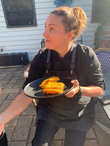 Chef Katie thinking about what she is going to do with the amazing fresh honeycomb