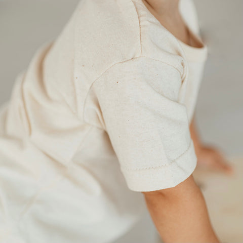 closeup of the creamy color and speckled texture of the everyday organic cotton kids tee