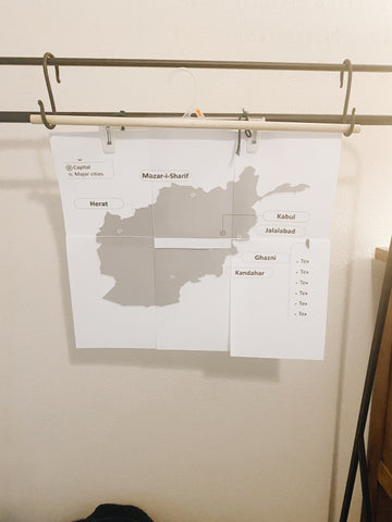 paper map on clothes hanger