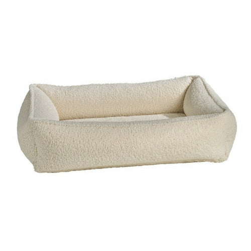Bowsers Urban Lounger Bolstered Nest Dog Bed — Faux Sheepskin Ivory