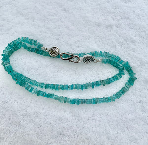 Fluorite stone necklace strung with silver spiral clasp