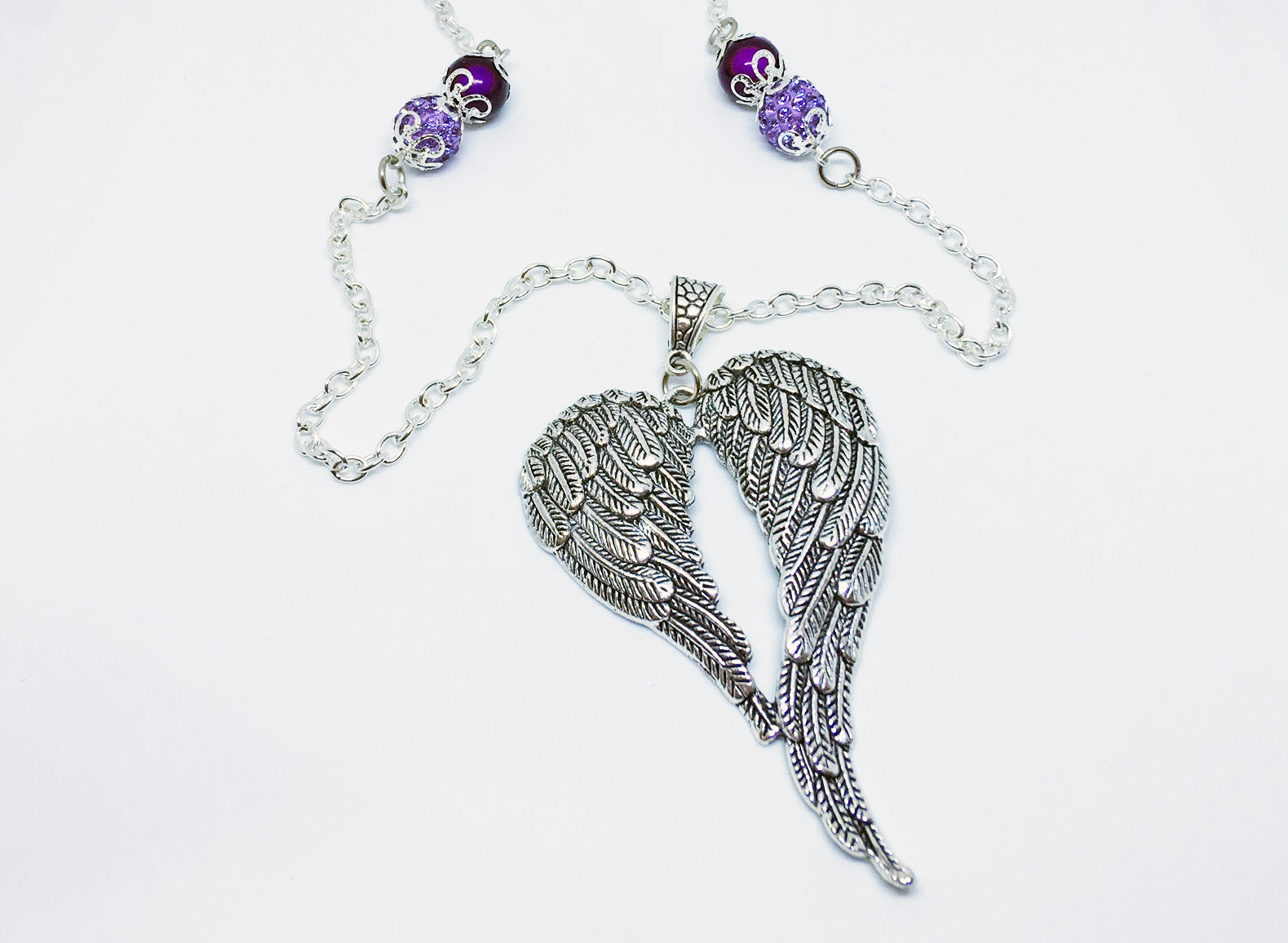 Special Order Buddha and Angel Wings Necklaces