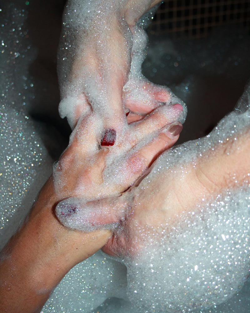 Hygienic clean hands being washed during a bath