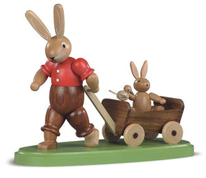 Easter bunny, male with child on wooden handcart