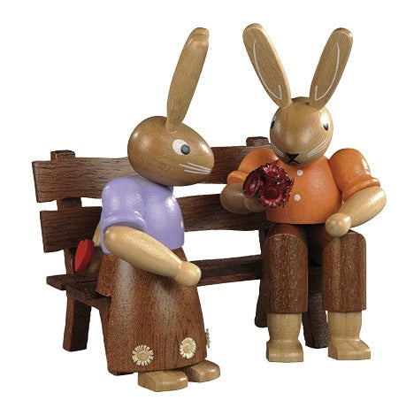Easter bunny, couple on garden bench