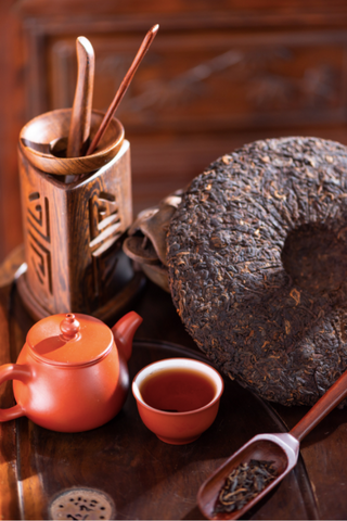 table with puerh and tea accessories
