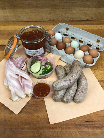 Breakfast Meal Pack includes a Dozen Pasture Raised Eggs, 1lbs Bacon, 4 House Breakfast Style Sausages, side of Jam, pickled vegetables. Save over $5 instead of buying individually