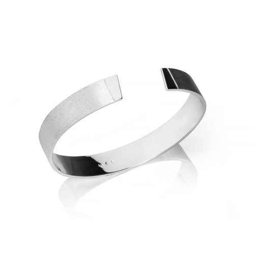 Handmade bangle for him inspired by the Pulpit Rock. Produced in Norway.