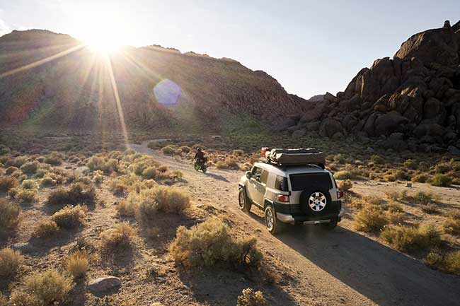 Overlanding through nature with your community.