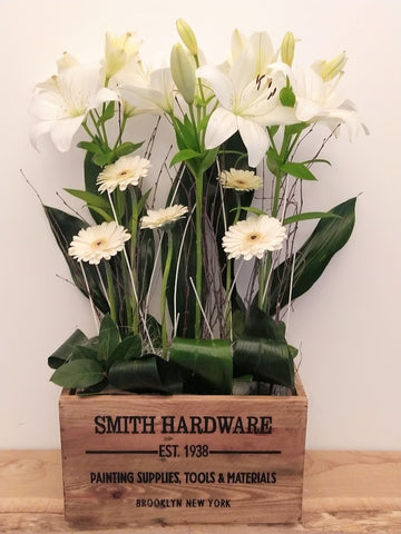 Gerbera and lily corporate flowers dorset. Flowers in a rustic crate Rustic flowers Dorset