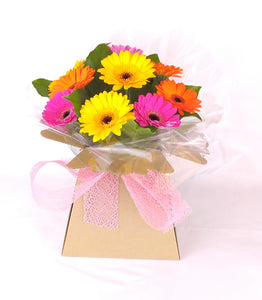 Gerbera Gift Box - Parks Florist, Providing fresh flower bouquets for all occasions. We supply fresh flowers for birthdays, anniversary flowers, new job flowers, new baby flowers, thank you bouquets, apology flowers and sympathy flowers. Delivering fresh flowers across Dorset including Dorchester, Blandford, Weymouth, Poole and Bournemouth. Qualified, experience florist. Fresh flower delivery Dorset