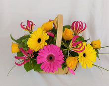 Load image into Gallery viewer, Flower basket - Parks Florist Providing fresh flower bouquets for all occasions. We supply fresh flowers for birthdays, anniversary flowers, new job flowers, new baby flowers, thank you bouquets, apology flowers and sympathy flowers. Delivering fresh flowers across Dorset including Dorchester, Blandford, Weymouth, Poole and Bournemouth. Qualified, experience florist. Fresh flower delivery Dorset
