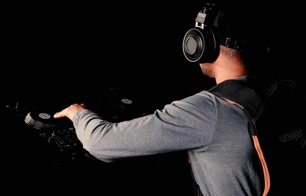 Dj playing music while wearing Woojer Vest Edge