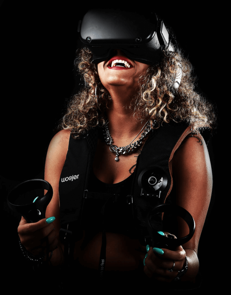 Girl playing VR while wearing woojer Vest Edge