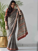 Beige Bagru hand block printed cotton saree draping style poses