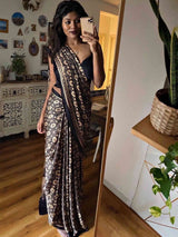 Black Eight Pointed Star Ajrakh Modal Silk Saree poses at home