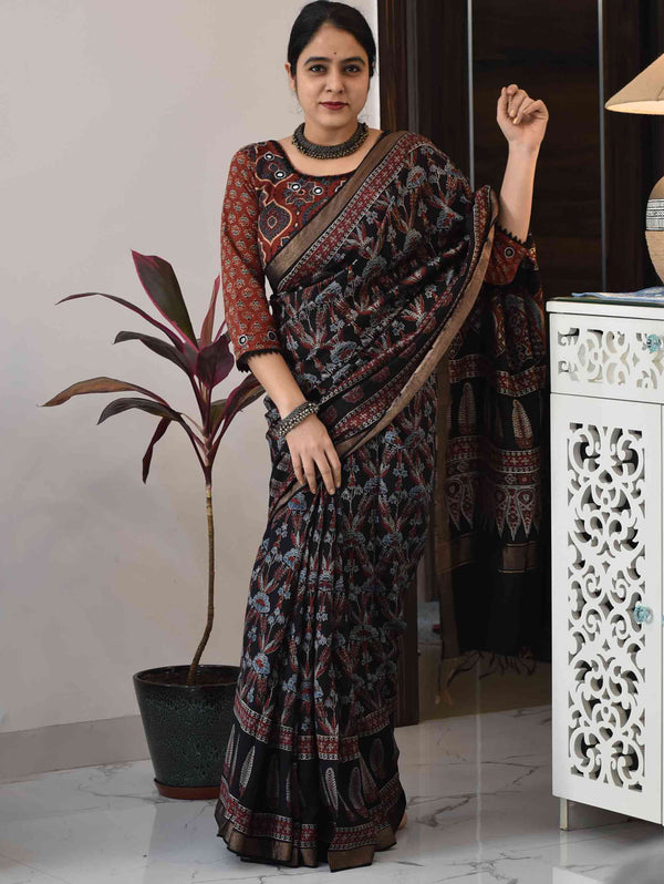Black floral Ajrakh handloom modal silk saree poses at home