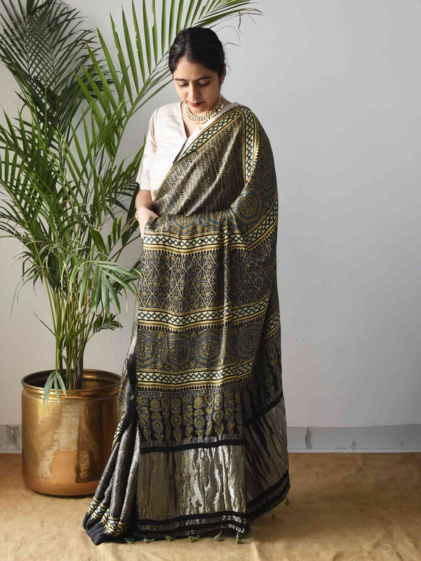 Black Leaf Gold Ajrakh Modal silk saree with zari pallu pose at home