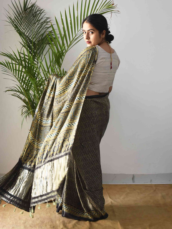 Black Leaf Gold Ajrakh Modal silk saree with zari pallu draping pose