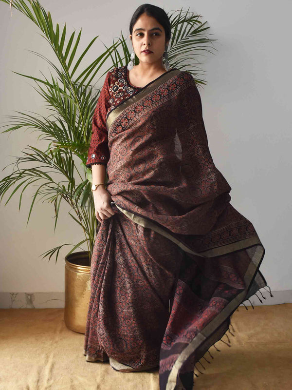 Brown Ajrakh Handblock Printed Linen Saree poses at home