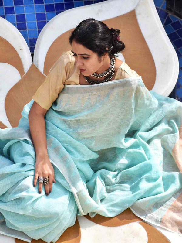 Aqua Blue Linen handwoven saree with temple border