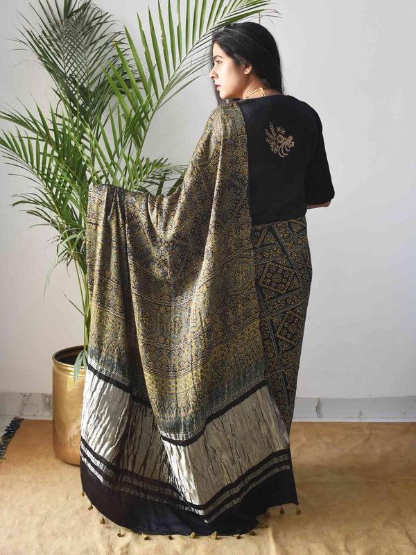 Gold Black stripes Ajrakh Modal silk saree poses home