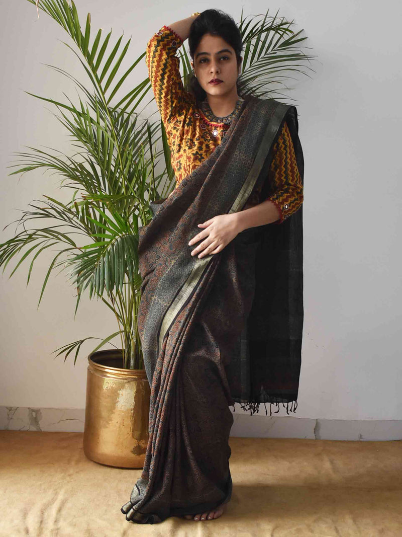 Green Ajrakh Handblock Printed Linen Saree poses at home
