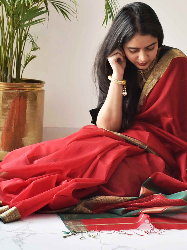 Red-Green Maheshwari Silk Saree with Zari Pallu and Border sitting pose