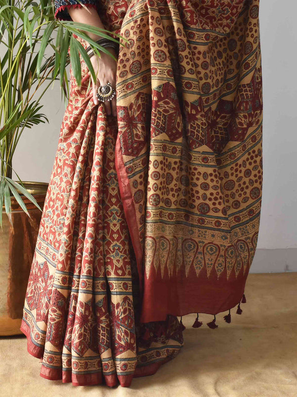 Red Ajrakh Handblock Printed Handwoven Eri Silk Saree with Zari border close up photo