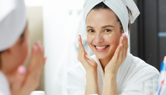 women washing face keeping good skin care