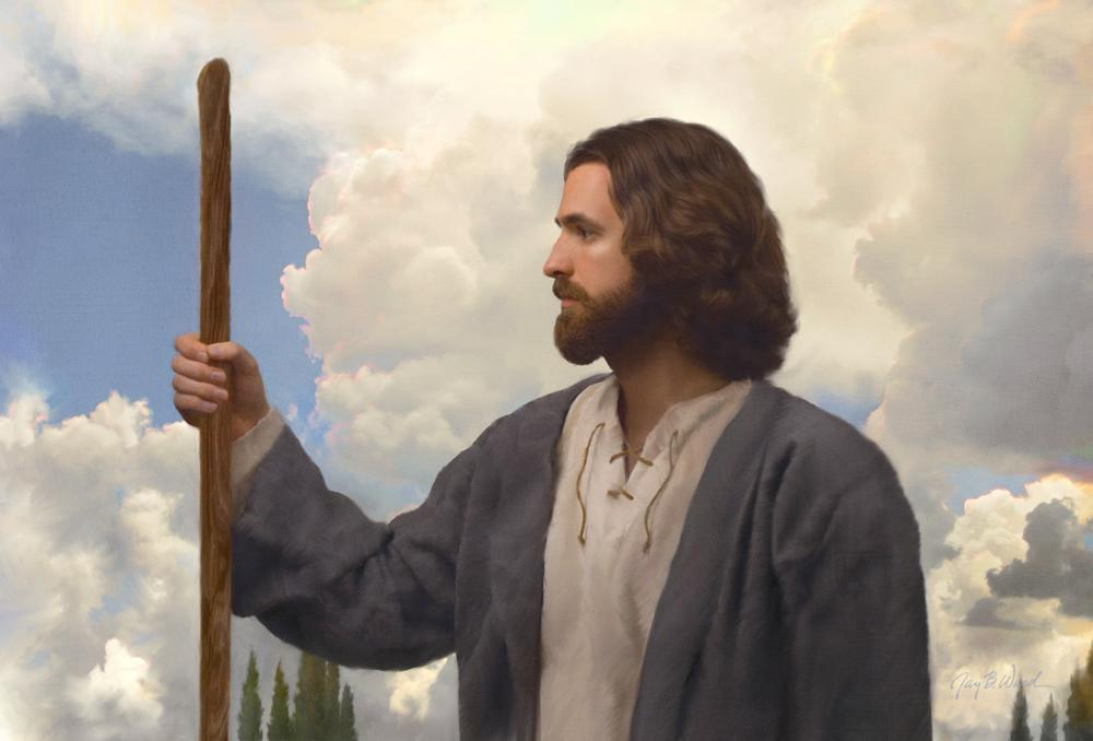 white cloud frames profile of Jesus in blue robe holding a staff