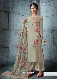Spruce  Salwar Suit With Floral Embroidered Neckline And Buttis