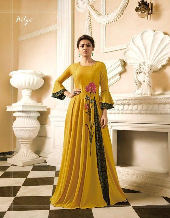 Magnetic Yellow Colored georgette party wear Kurti