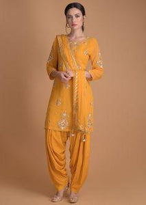 Spruce yellow Salwar Suit With Floral Embroidered Neckline And Buttis