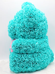 Turquoise rose teddy bear with pink heart