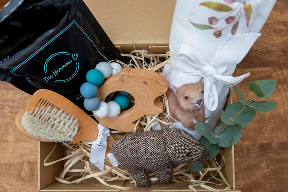 Wombat Baby Hamper - Wombat designed swaddle, wombat soft rattle, wombat wooden teether, bath soak, baby brush and comb
