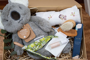 Koala Baby Hamper - Koala designed organic muslin swaddle, teether rattle, baby brush and comb set, hand cream, essential oil roll on