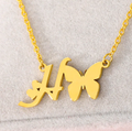 letter h necklace with butterfly pendant