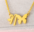 letter n pendant necklace and butterfly