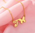 initial t necklace with heart and butterfly
