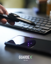Load image into Gallery viewer, GuardeX UV-C Pen, portable cleaning light wand for home, office, airplanes, cars, buses, subways, travel, ultraviolet light pen, kills 99.9% of viruses and bacteria, in use on phone